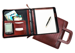 zippered binder made of red crocodile-grained Italian leather